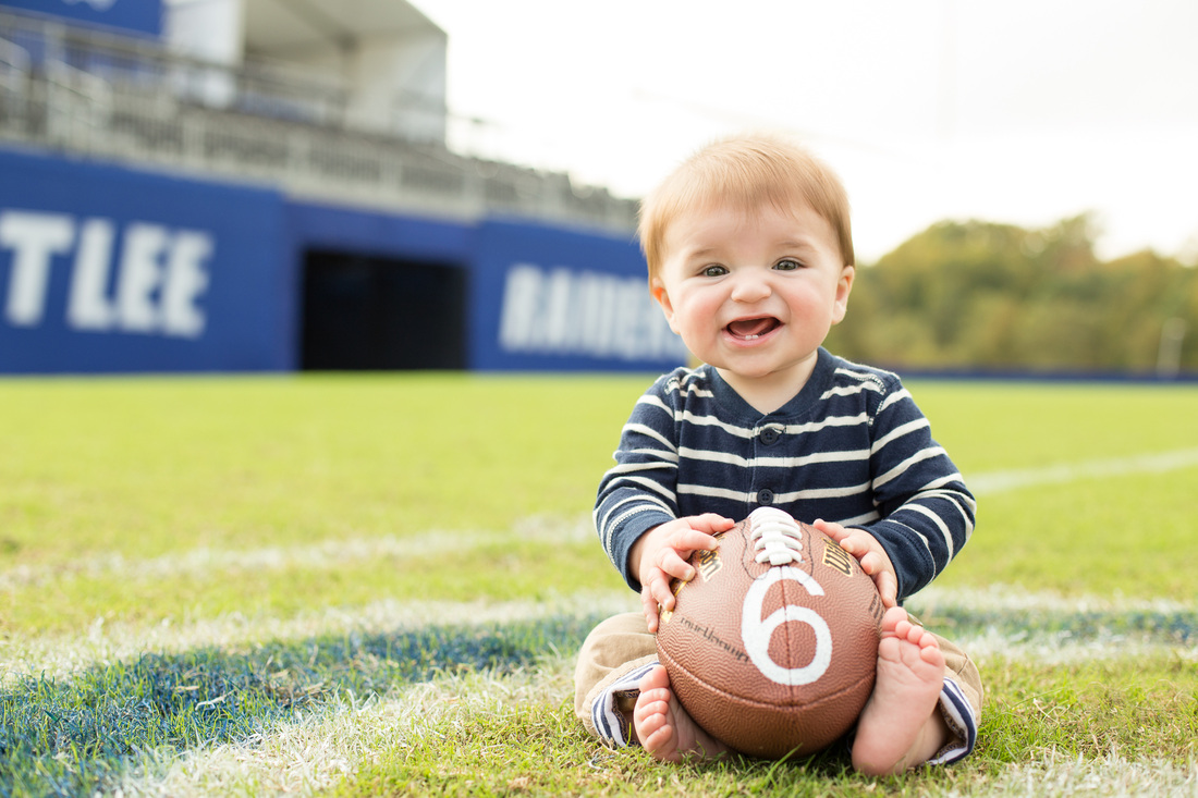 baby both with 2 teeth and football; atlee raiders