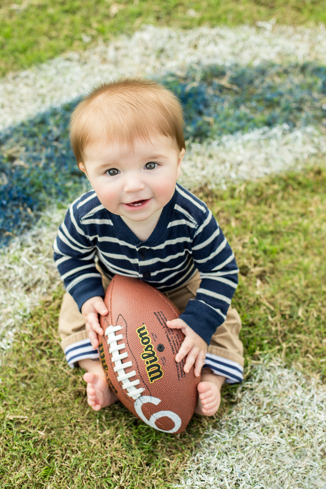 baby boy with football; 6 months