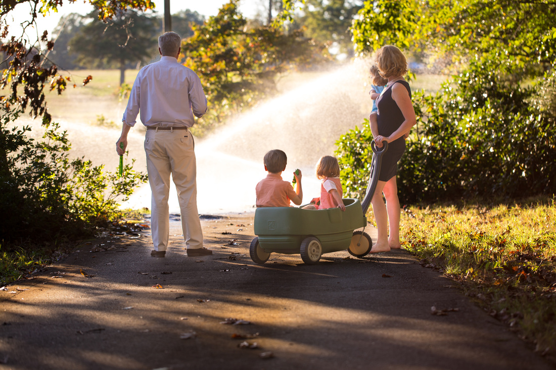 Family looking at sprinkler